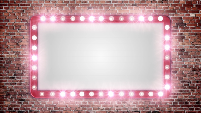 A blank marquee sign on a red brick wall with flashing lights.  | Shutterstock HD Video #1034673560