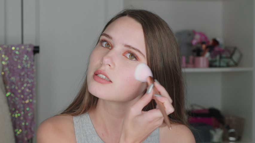 Beautiful teenage girl vlogger filming makeup tutorial sharing beauty video enjoying social media influencer recording vlog at home | Shutterstock HD Video #1034674187