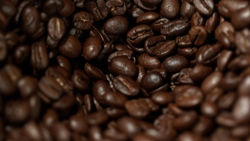 Super Slow Motion Shot of Rotating Coffee Beans in the Grinder at 1000fps. | Shutterstock HD Video #1034690996
