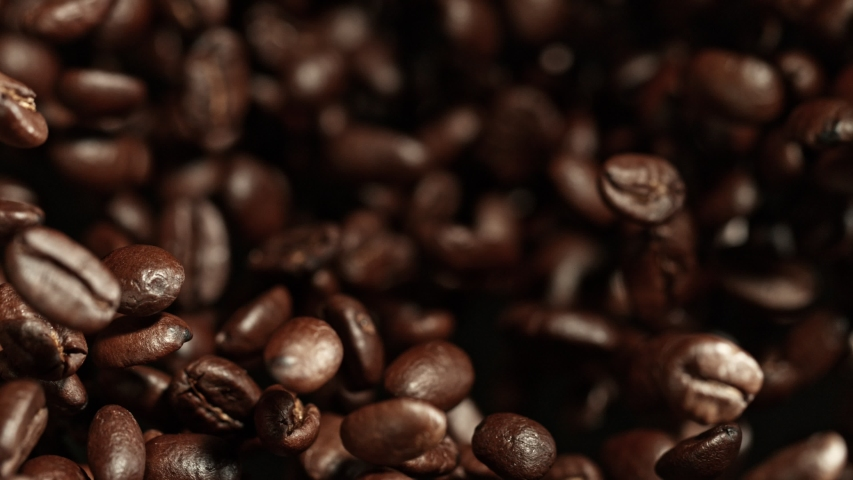 Super Slow Motion Shot of Exploding Premium Coffee Beans Towards the Camera at 1000fps. | Shutterstock HD Video #1034691038