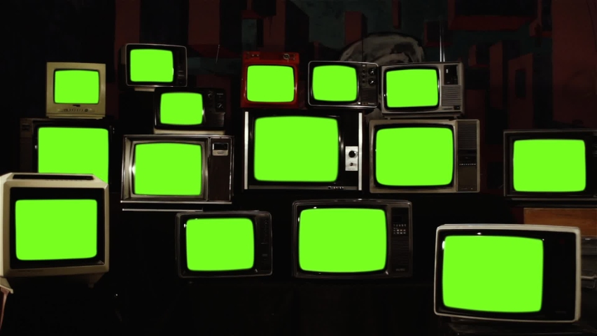 "Stack of Retro Vintage TV Turning On Green Screens. You can replace green screen with the footage or picture you want with ""Keying"" effect in AE (check out tutorials on Internet)."