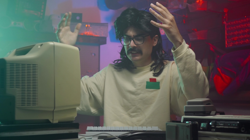 In the '80s or '90s.. A frustrated computer nerd slapping his personal computer and keyboard. Retro scene with vintage colors and atmosphere.