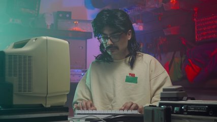Computer nerd from the '80s or '90s looking right at the camera and giving a thumbs up. Retro scene with vintage colors and atmosphere.