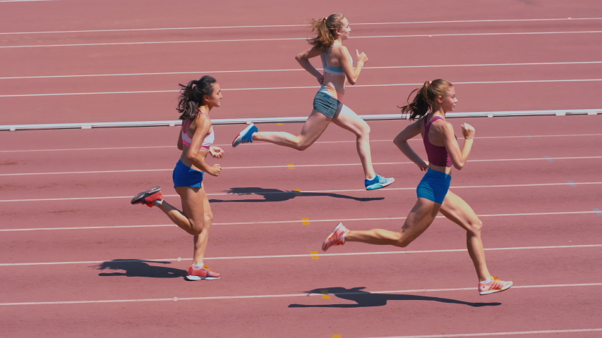 High-angle shot of female sprinter race on outdoor track arena