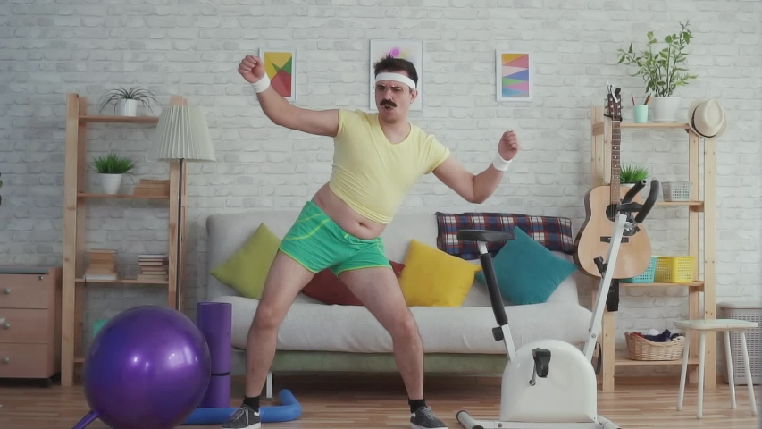 Expressive overweight man with a mustache and glasses funny dancing slow mo