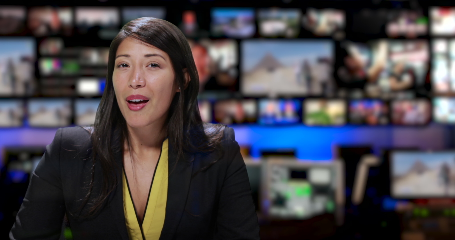 MS Female anchor speaking at news desk   Shutterstock HD Video #1034745584