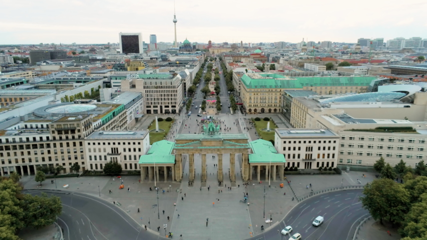 Aerial View of Brandenburg Gate (Brandenburger Tor) - monument in Berlin, Capital of Germany, Europe, with Skyline at the Background. 4K Zoom Out Shot of European City Landmark