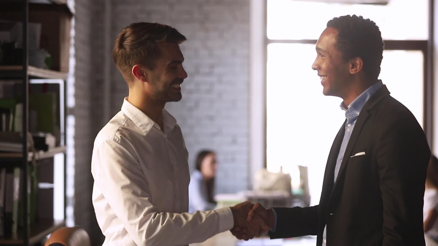 European and black businessmen stands in co-working office discuss document contract details finish talk shaking hands, client and executive manager effective meeting, synergy working together concept Royalty-Free Stock Footage #1034756150
