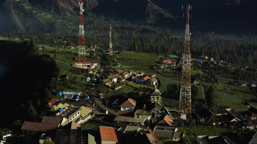 Aerial view of Communication towers build on high altitude agriculture plantation village near Mt Bromo Indonesia | Shutterstock HD Video #1034770850