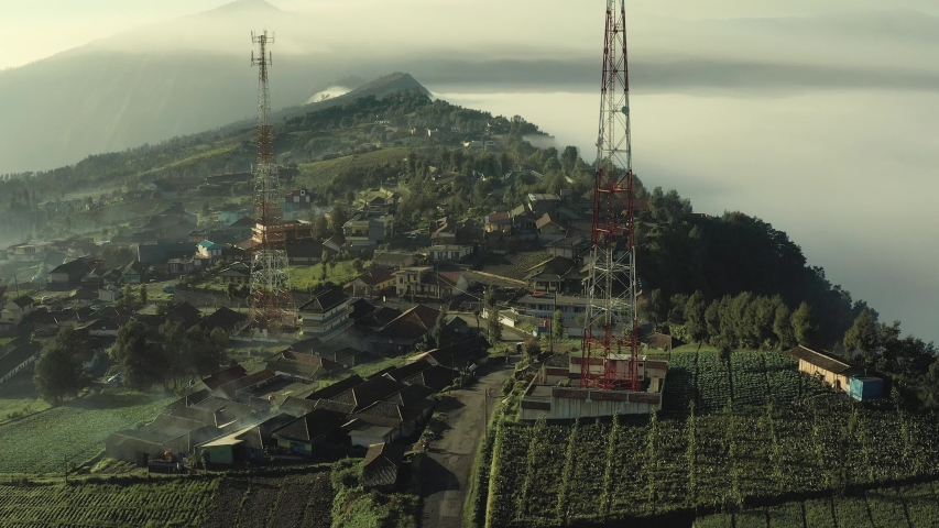 Aerial view of Communication towers build on high altitude agriculture plantation village near Mt Bromo Indonesia | Shutterstock HD Video #1034770853
