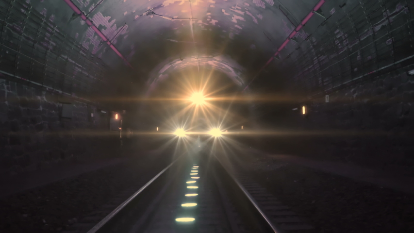 Extreme train coming towards camera in a railway tunnel. Representing achieving your goals, getting through problems and obstacles or problems seem bigger than they really are Royalty-Free Stock Footage #1034777420