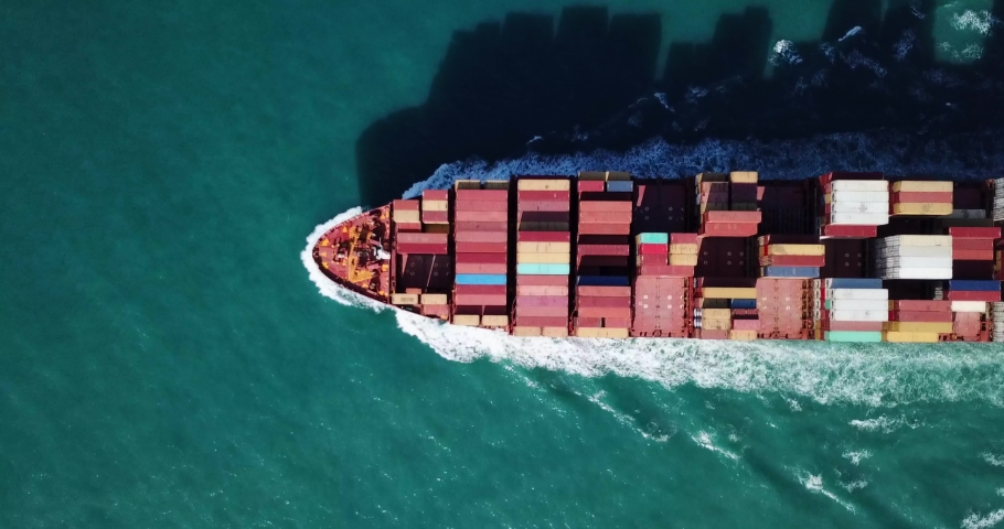 Aerial footage of a Large Container ship at sea. #1034783951