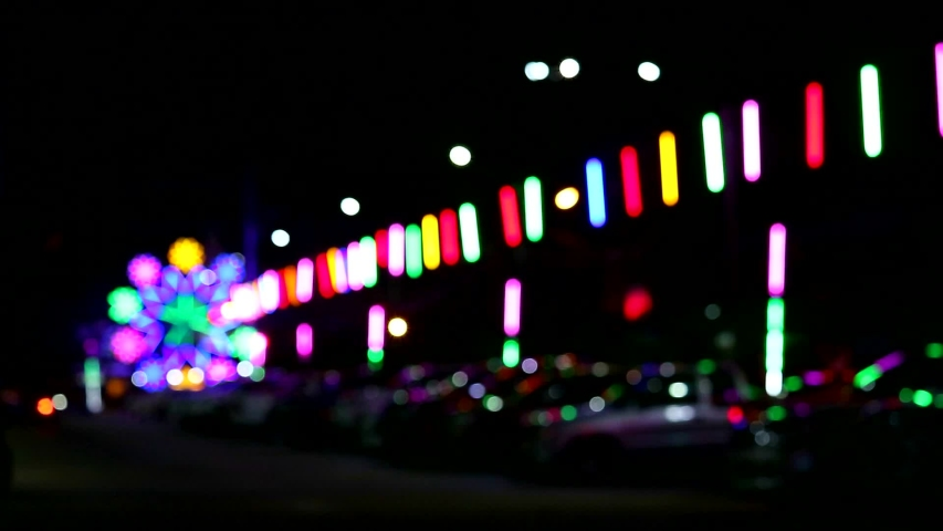 blur neon light and silhouette car and people in night market fair parking area #1034786516