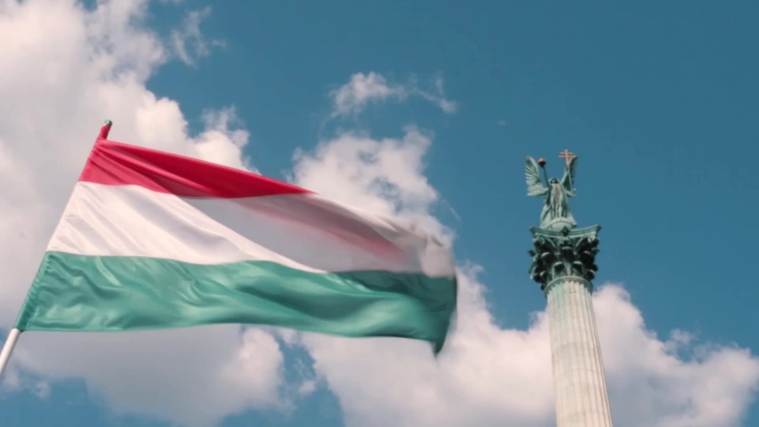 Flag of Hungary swaying in the wind on the heroes square in Budapest dedicated to the Millennium of the Hungarians homeland   Shutterstock HD Video #1034790533