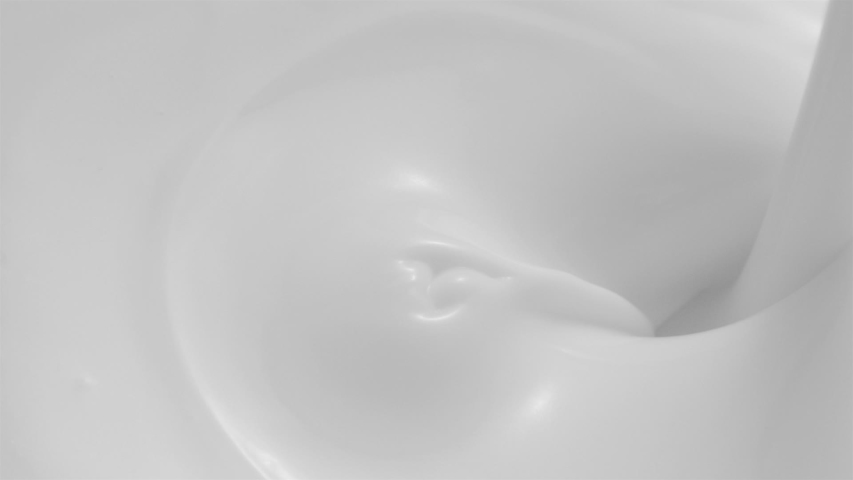 Close-up of Fresh Milkshake Cream or Cosmetic Lotion Pouring in High Speed at 1500 fps