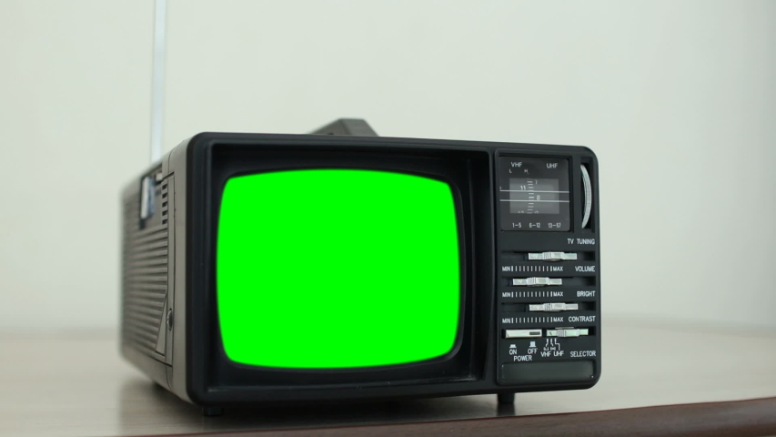 Old TV with a green screen in the room | Shutterstock HD Video #1034801540