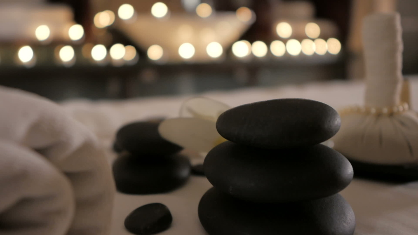 Beautiful spa composition on massage table in wellness center Royalty-Free Stock Footage #1034803403