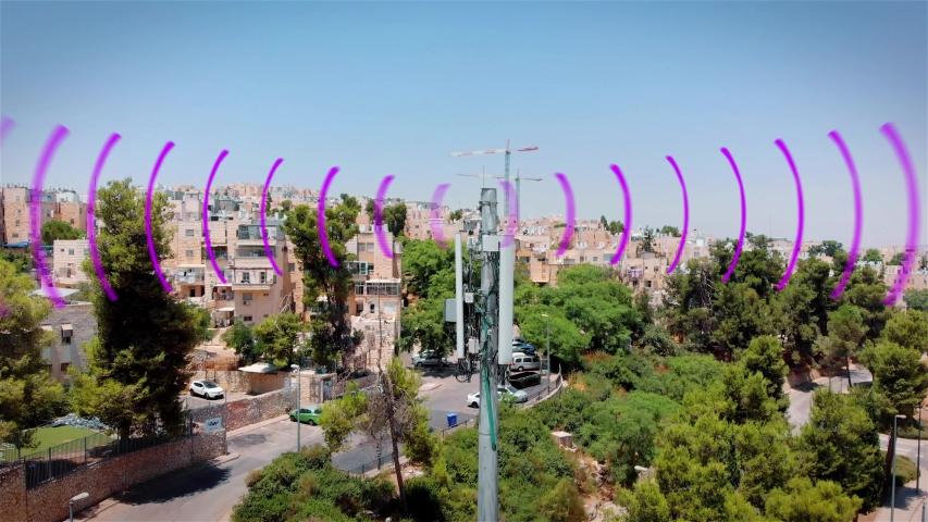 Aerial footage of Celular antenna Emitting Radiation and radio waves Visualization of radio waves coming from a Celular antenna Populated  neighborhood emitting radio signals, drone  | Shutterstock HD Video #1034806871