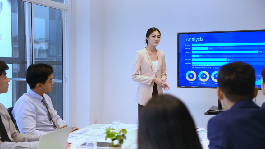 Business concept. Women are presenting work at the meeting. Royalty-Free Stock Footage #1034820299