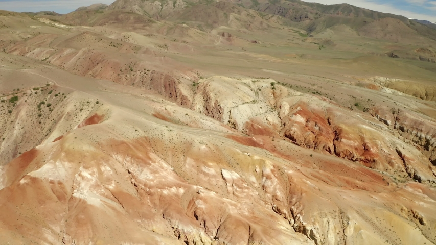 Colored rocks . Flying over red rock formation in Southern mountains. Aerial shot, 4K. | Shutterstock HD Video #1034834762
