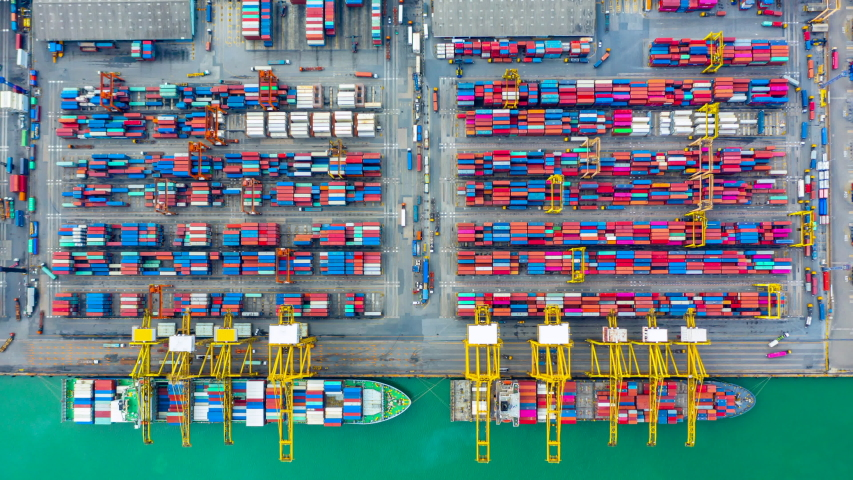 Container ship loading and unloading in port, Aerial view container shipyard business commerce trade logistic import and export cargo freight ship, transportation by container cargo ship, Timelapse 4k