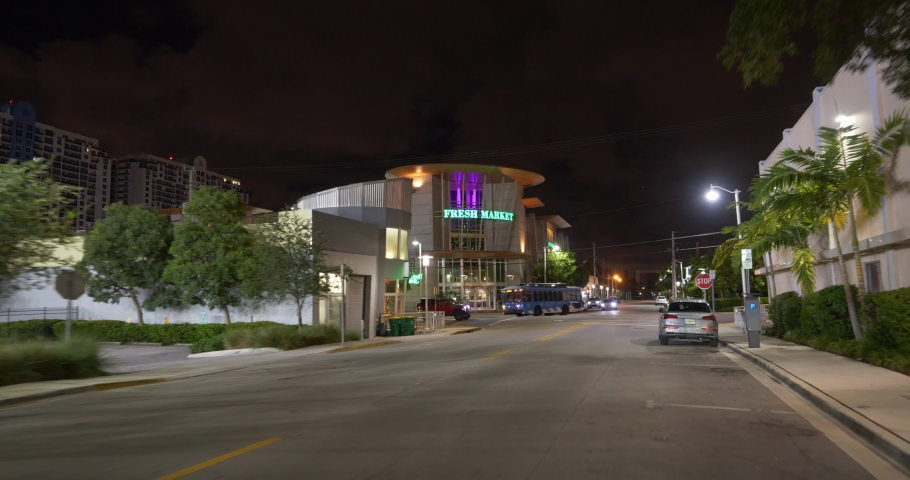 MIAMI BEACH, FL, USA - AUGUST 5, 2019: Fresh Market health food store Miami Beach shot at night with gimbal stabilizer  | Shutterstock HD Video #1034889293
