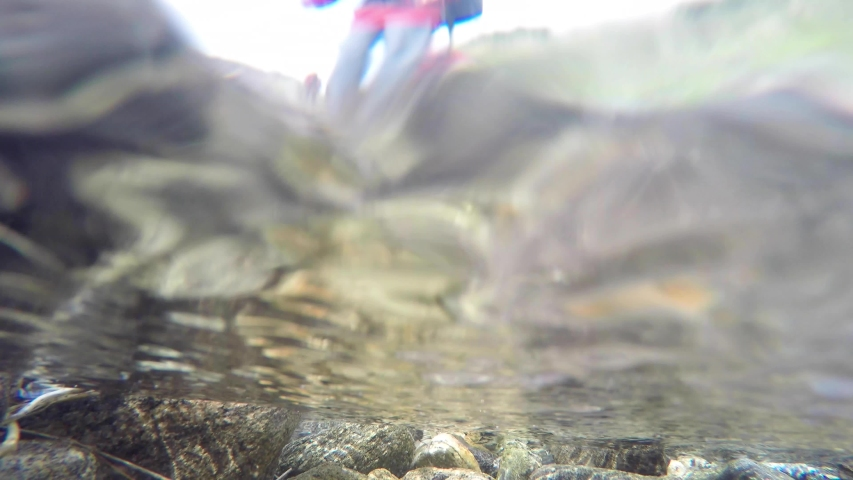 Underwater view of a mountainous river of Uttarakhand, India.River Ganges.Crystal clear water of Holy Ganges. Royalty-Free Stock Footage #1034896919