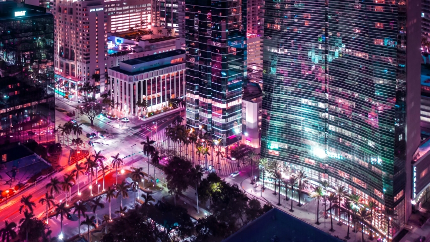 Miami downtown motion timelapse hyperlapse. Beautiful aerial shot of Miami city. Colorful Motion Time Laps of Miami. Drone flying over a city night lights Miami in 4K