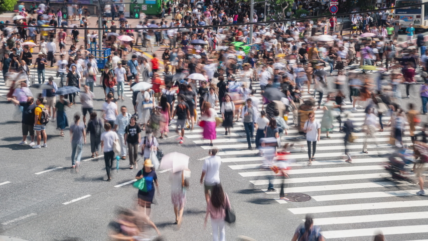 4K Timelapse high angle view of busy crowded pedestrian business people man and woman worker with tourist walking crossing street crosswalk with traffic driving cars at Shibuya, Tokyo City, Japan