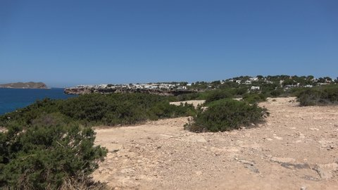 Nature and landscapes on the island of Ibiza. View from a helicopter spans over the sea. Beautiful views.
