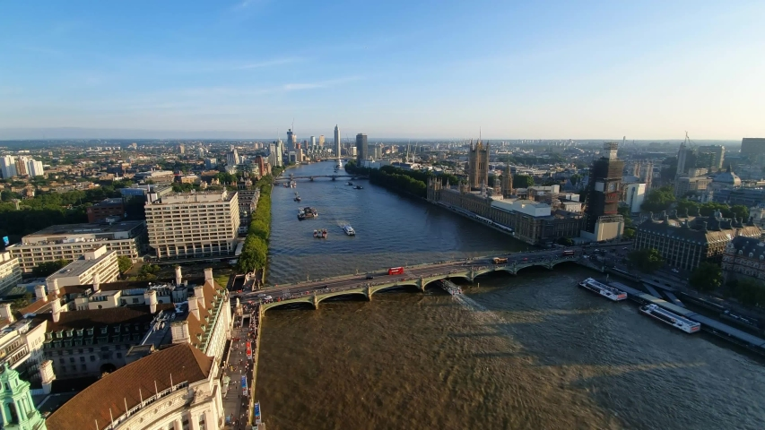 Aerial view of Westminster Bridge and River Thames in London, United Kingdom | Shutterstock HD Video #1034973233