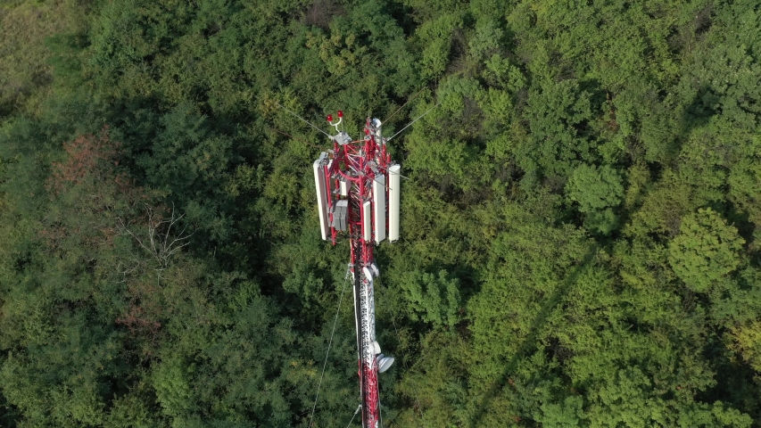 Radio and TV communication mast from above 4K drone footage | Shutterstock HD Video #1034997779
