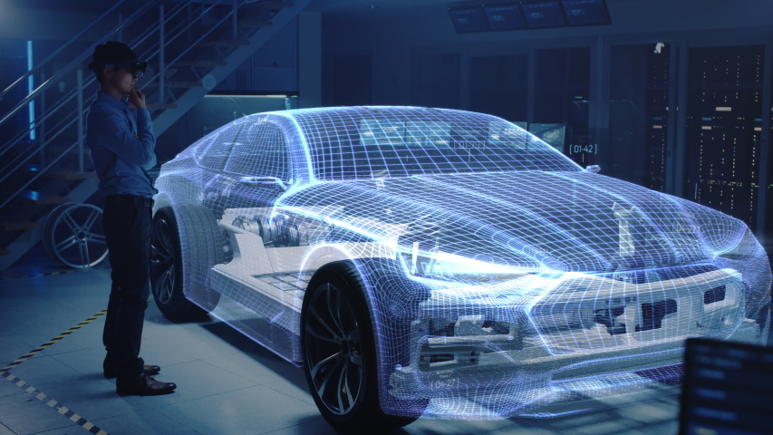 Engineer Wearing Augmented Reality Headset Chooses Body for New Electric Car Concept. 3D Graphics Visualization Shows Vehicle Frame Developing in Real Time into Futuristic Concept