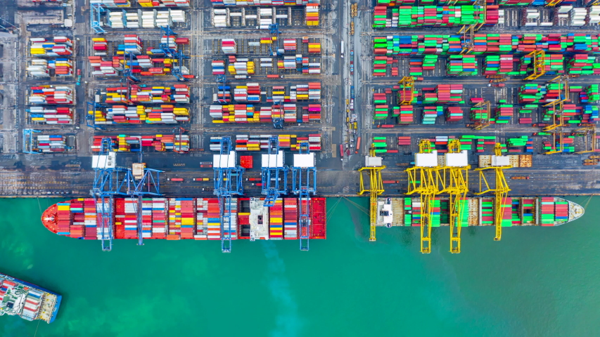 Aerial view time lapse container ship carrying container in import export business logistic and transportation of international by container cargo freight ship, Container ship at industrial port, 4K