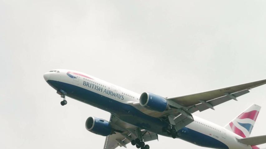 Bangkok , Bangkok / Thailand - 06 15 2019: British Airways Boeing 777-236(ER) G-YMMF approaching before landing to Suvarnabhumi airport in Bangkok at Thailand. 4K Slow Motion from 59.94 fps to 29.97 f