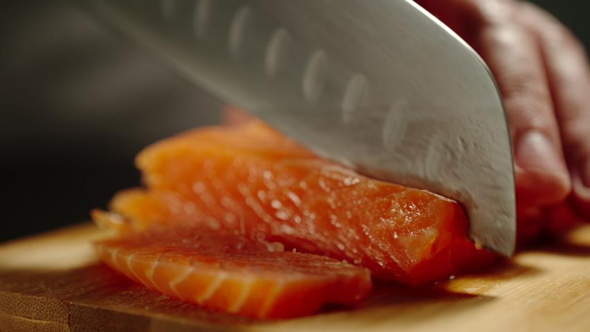 Man Cutting Red Fish On Wooden Board | Shutterstock HD Video #1035042227
