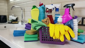 different products and items for cleaning on the floor in the kitchen. Concept cleaning. Dolly video