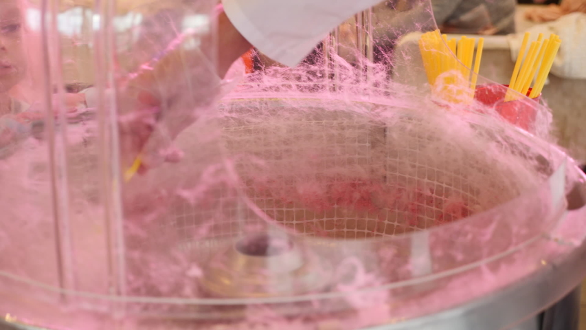 Production of pink cotton candy on holiday in the hall | Shutterstock HD Video #1035065609