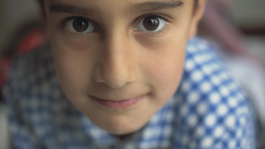 Close-up of a cute little arab boy looking at the camera and smiling