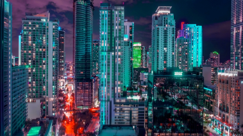 Miami downtown timelapse hyperlapse. Beautiful aerial shot of Miami city. Colorful Motion Time Laps of Miami. Drone flying over a city night lights Miami in 4K