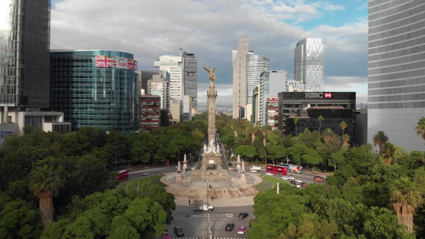 MEXICO CITY, MEXICO - JULY 2019: Aerial panoramic view of the monument called Angel de la Independencia during sunrise.
