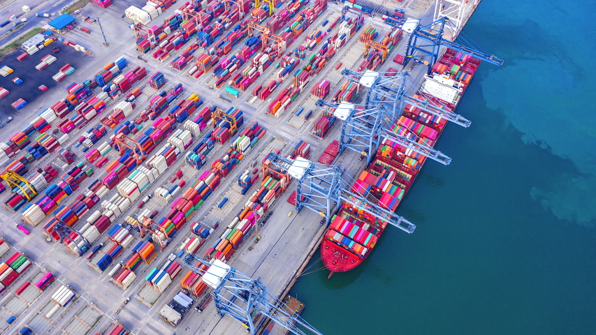 4K Timelapse of modern industrial port with containers from top view or aerial view. It is an import and export cargo port where is a part of shipping dock
