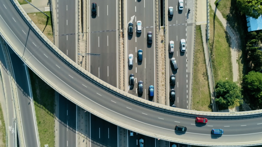 Transportation and Infrastructure: Highway Overpass and Junction with Cars, Trucks and Buses. Aerial View of Road Traffic Jam at Daytime Rush hour in Warsaw, Poland. 4K Close Up Fly Over shot