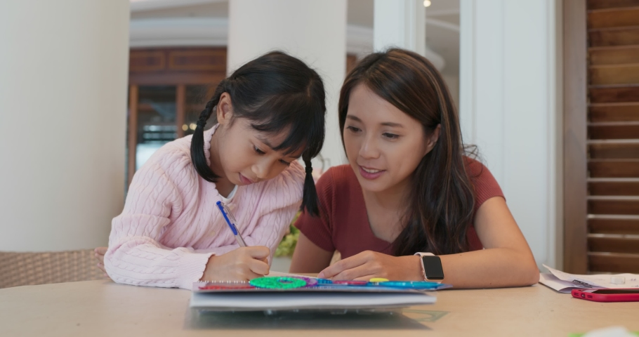 Woman with her daughter draw together