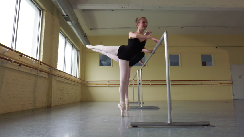 Slow motion shot of ballerinas practicing at the barre | Shutterstock HD Video #1035164663