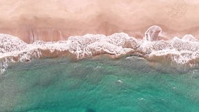 aerial sea watching people on the beach and wave foams view of the patara beach