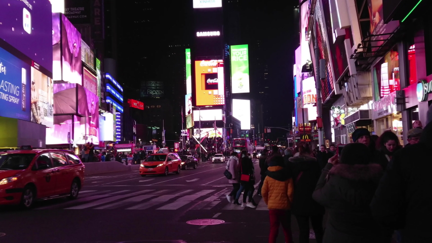 New York / United States - 02 11 2019: Evening crowd and traffic in Times square in New York on a winter night 4k | Shutterstock HD Video #1035237614