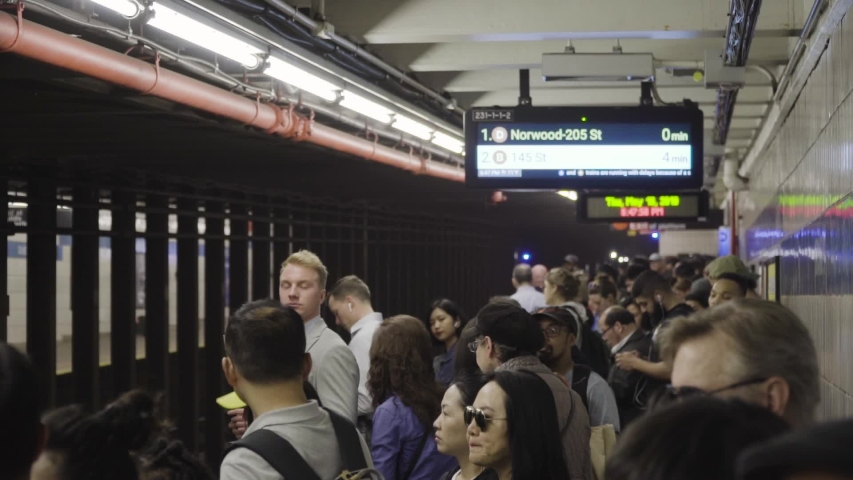 New York , New York / United States - 05 16 2019: People Getting on Subway in New York City