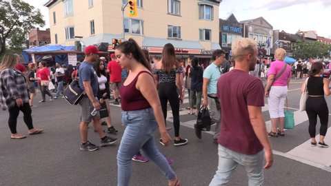 Toronto, Ontario, Canada August 9 2019 Crowds of people on the Danforth Greek village enjoying the food and summer weather