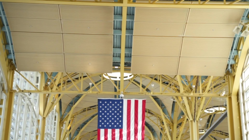 Washington D.C. , D.C. / United States - 05 21 2019: Pan Down of American Flag in Ronald Reagan Airport